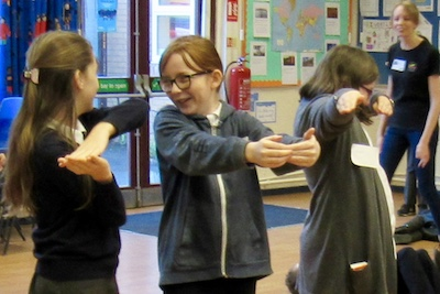 pupils laughing confidence in drama club